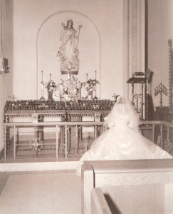 My mother praying in front of the statue of the Blessed Mother (1955).